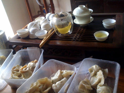 "Tea leaf and pork dumplings (猪肉茶叶饺子) for lunch at Tranquil Tuesdays today! We are very fortunate the Tranquil Tuesdays offices are located really close to one of Beijing's best dumpling restaurants: Xian'r Lao Man 馅老满.  I used to travel across town to eat here regularly when I didn't work as close as I do now.  In fact, I even brought famed food writer and Beijing restaurant authority, Savour Asia, here back in 2008. Anyways, so we are lucky to get to eat at Xian'r Lao Man a lot for lunch.  Or even better, get the dumplings delivered straight to us.  Last time we were there, Xiao Zhang noted they had a ""tea leaf and pork dumpling"" on the menu and resolved to try it next time we ate there. So today when we decided we both wanted dumplings for lunch, she ordered the tea leaf and pork dumplings.  With one bite the predominant flavor from the tea leaves was very floral and we each and jointly concluded they used jasmine green tea (a Beijing tea favorite) which is a green tea scented with jasmine flower oils.  So in the end it was just ok.   I mean, it wasn't really the flavor of tea leaves anyways, but rather the flavor of the jasmine oil that we were tasting. You will note from the photos, that we are using our Crystalline Glaze tea cups as a vinegar dipping bowl for our dumplings.  As we tell all our customers, our tea cups and teaware are multifunctional! _____________________________________________________________________ If you enjoyed this article, sign up for Tranquil Tuesdays' newsletter to  Explore the stories behind each of Tranquil Tuesdays teas and teaware Travel with Tranquil Tuesdays seeking the best teas and teaware in China Learn the historical and cultural elements that make Chinese tea and teaware so unique Sign up for Tranquil Tuesdays' newsletter now!"