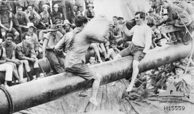 At Sea. A greasy pole pillow fight contest in progress aboard troopship Aeneas (A60) during a November 1919 to January 1920 voyage carrying AIF troops home from England. (Extracted from troopship Aeneas Diary)