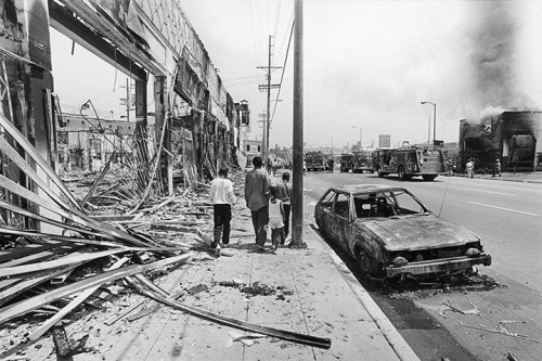 Photograph: Ted Soqui/Corbis It's 20 years since the race riots sparked by the police beating of Rodney King that shook Los Angeles and the US. See how the LA streets affected look now and how the news was covered with reports from our archive: From the archive: Riots fire US race divide  The United States was tottering last night on the brink of a new racial crisis, pitting black against white in the nation's cities, which turned Los Angeles into a war zone on Wednesday night. In Atlanta, the last resting place of Martin Luther King, students went on a copycat rampage in a shopping mall. Police reported a number of beatings and arrests. In Washington, President Bush went on television to appeal for calm, trying to contain a potentially explosive situation nationwide after the acquittal of four Los Angeles police officers accused of beating a black motorist, Rodney King.