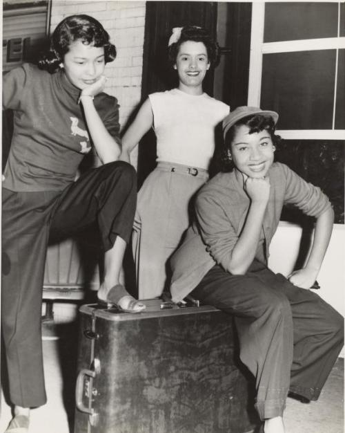 "blackhistoryalbum:  She's So Fly | 1940s Three women, one wearing dark sweater with two daschund appliques, posed around a suitcase in front of brick building, 1940s. Charles ""Teenie"" Harris, photographer. Teenie Harris Photograph Collection, 1920-1970, Carnegie Museum of Art, Pittsburgh, PA. FIND US ON TWITTER 