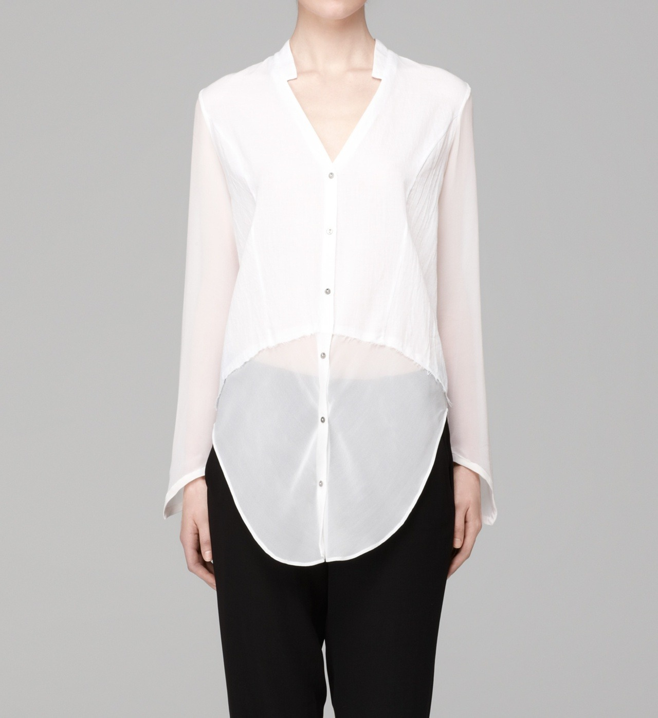 hlangjournal:  THE WHITE BUTTON DOWN, REINTERPRETED.  It's a fabric mash up with sheer cuts and opaque angles. Shop the Element Shirt.
