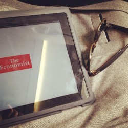Catching up on my digital edition of @TheEconomist #iPad #Plane #reading #theeconomist #economist #newyork #airlines #united #business #world #news #raybands #italianmade #leisure #relax #politics #brand (Taken with instagram)