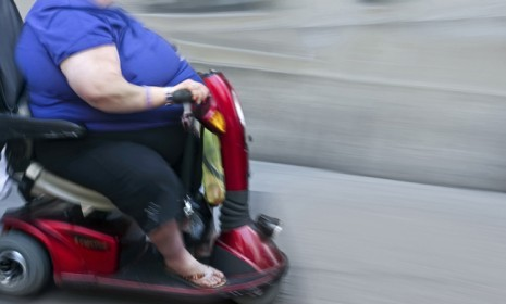 A new report estimates the national cost of accommodating obese citizens at $190 billion a year.  Included in that figure: hospitals widening bathroom stalls, stadiums installing larger seats, the Federal Transit Administration testing new steering and breaks on mass transit systems, and thousands of dollars per person in medical expenditures. Here's a look at some unexpected financial costs of obesity, by the numbers: 35.7 — Percentage of U.S. adults considered obese 400 — The new minimum seat threshold, in pounds, for subway trains in New York 9.4 — Extra sick days obese women take every year compared to their coworkers $3,792 — Annual cost to workplaces due to lost productivity for every obese male worker $5 billion — Extra annual cost of gasoline required to fly overweight passengers on airplanes More numbers