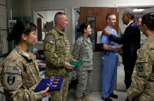 President Barack Obama greets hospital personnel in the ICU at Bagram Air Field, Afghanistan, May 1, 2012. The President presented ten Purple Hearts, three in the ICU. (Official White House Photo by Pete Souza)