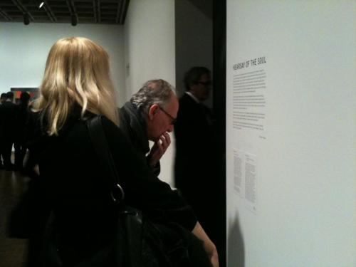 Werner Herzog reads his wall label at the 2012 Biennial opening party.  Herzog will discuss his Biennial contribution with exhibition curators Jay Sanders and Elisabeth Sussman Thursday, May 17 at noon. Free with admission, but reservations are required.