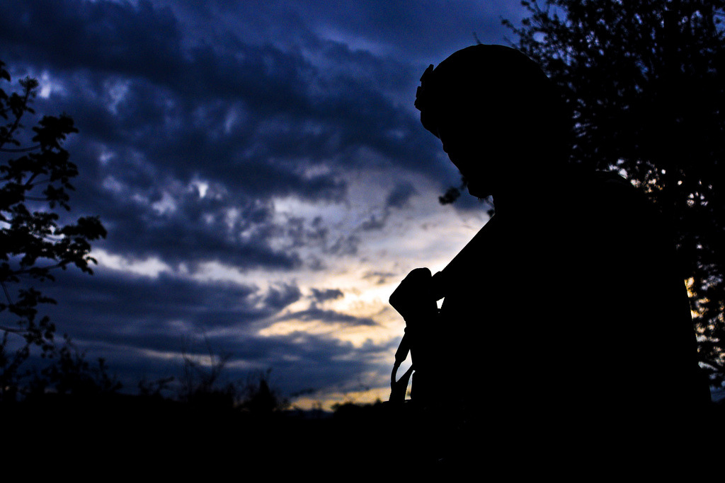 Image description: U.S. Army Staff Sgt. Charles Stokes pauses while on patrol in a local village near Combat Outpost Terezayi on April 10. Photo by U.S. Army Spc. Eric-James Estrada