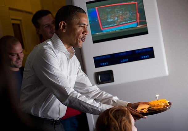 The President loves to present birthday cake to reporters while on Air Force One. Sadly, on this day they only had polenta.