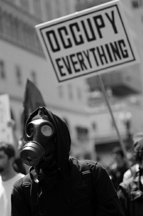 politics-war:  A demonstrator marches with a gas mask on during May Day in Oakland, Calif., Tuesday, May 1, 2012.