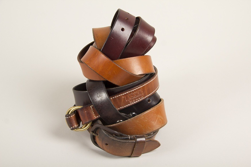 A collection of our craftspeople's belts, all in various stages of wear.