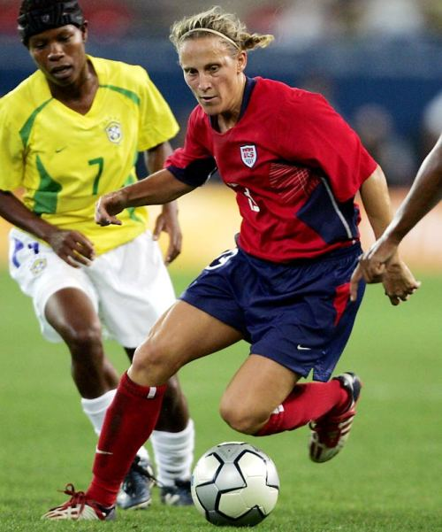 footyfanomenon:  Top 40 Athletes of the Title IX Era   #33 Kristine Lilly  Lilly retired in 2011 as the world's all-time leader in appearances (352 caps). The three-time U.S. Soccer Athlete of the Year finished with 130 international goals and 105 career assists, second only to Mia Hamm in national team history. Before becoming both the youngest and oldest player to record goals for the U.S. in a career that spanned four decades, Lilly helped the University of North Carolina to four consecutive national titles. In 1994, the Tar Heels retired her No. 15 jersey. Read more