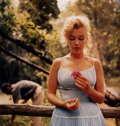 Marilyn Monroe in Seven Magazine The beautiful Marilyn Monroe (Norma Jeane Mortensen Baker) with her lover Arthur Miller. Arthur seems to be picking something up while Marilyn Monroe poses with a flower. Even though our definition of beauty changes, Marilyn Monroe seems to always remain one of the most beautiful women who have walked on this earth.