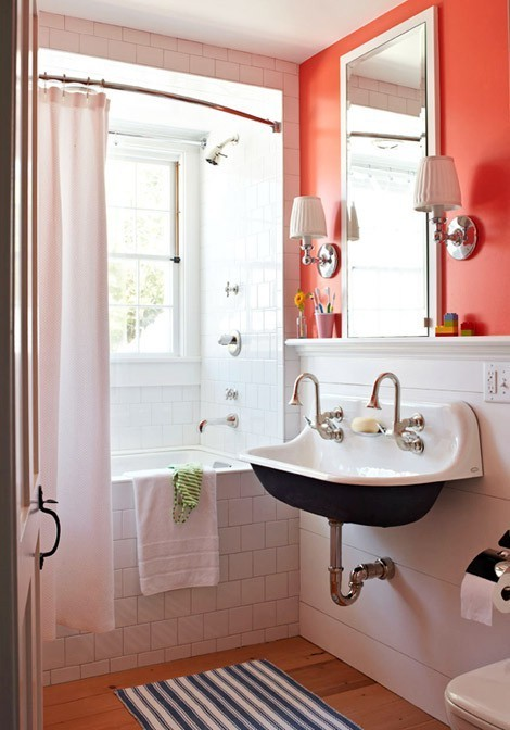 bright bathroom with coral wall