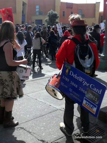 Hey drummer, nice sign. At the general strike march, Occupy Oakland, May Day.