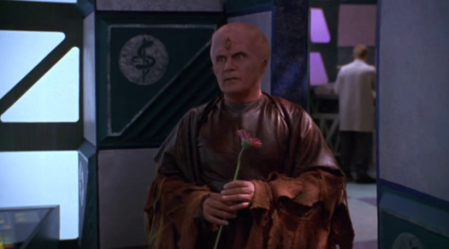 Babylon 5, The River of Souls When fandoms collide! Martin Sheen turns up as a guest alien in a Babylon 5 TV movie. In one scene he awkwardly offers Tracy Scoggins a flower. One day I probably stop finding this one screenshot inherently hilarious. But that day is not today. (Al Swearengen is also in River of Souls, but he doesn't have a ridiculous costume or a flower, so it's less exciting.)
