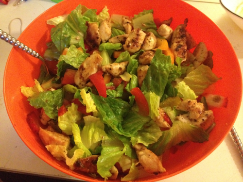 SALAD! w/ strawberries, peppers, oranges, and grilled chicken :) dressing on the side ;)