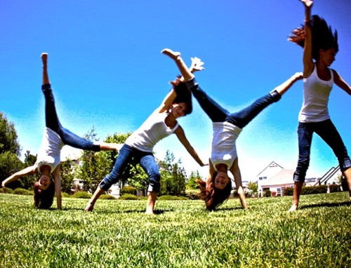 Ahhhhhh, cartwheels! A forgotten fav! These were SOOOO much fun to add into my  workout PLAYout today! Still got it too! By the end I was busting out some seriously gorgeous round offs! #tootingmyownhorn Note: not for everyone! Use your judgment (& crash mats) if it's been awhile! As I was laboriously flipping about today, I couldn't help thinking how EASY IT WAS to spend hours 'playing' when I was a kid. Hours running, jumping, flipping, skipping etc. 100 cartwheels at age 8 was nothing. 100 cartwheels at almost 30? A FEAT OF EPIC PROPORTIONS, lol.  I like to play when I workout, as much as possible (I play HARD y'all). Finding things that are fun to do, turning it into a game and letting loose are MY keys to staying fit and enjoying what I do so much.  Came up with a few ideas from my childhood that can help you have more fun with your workouts this summer!  Childhood 'Play' ideas to help you have more fun with your workouts.  1. Skip its. I made my own D.I.Y model after a dollar store version crapped out on me (you get what you pay for!). Used an old pair of tights, stretched them out and knotted them with a loop for my ankle. Put a hole through a rubber ball (bigger than a tennis ball and about 1-2lbs) and threaded the fabric through, tying it on the end. Kinda genius. You can also find cheap quasi-versions here .2. Hop Scotch. Got chalk? Agility drills, speed work, footwork etc. Plus, ya know, FUN. See games & patterns here.3. Jump rope. Still working on getting back to my 8 year old skipping level, but getting a great workout even when I mess up. I used to jump rope all the time and it NEVER felt as hard as it does now. How long has it been since you've payed double dutch? Grab a few friends (or tie one end to a tree) and play. 4. Hula Hoopin'. Making your own? The hoops need to be weighted slightly, but a little sand and some duct tape can turn a cheap hoop into a fun tool. Around the legs & arms is a great way to add some resistance training too! You can also opt to buy a weighted hula hoop for an extra burn this summer! 5. Red Light, Green light. Such a fun game! Speed intervals anyone? (Once we get outside, this is gonna be WICKED with my bootcamp. Instructors - try 'red light' in a squat hold). Never played? Instructions here. 6. Monkey bars. Easy, right? Not so much! Trying to get from one end to the other is tough stuff when you're big. Great upper body work. If you just wanna hang there, some leg raises can help that core too!   The SKY's the limit when you pull out your inner child! Any other ideas for how to add a little more PLAY into your workout?
