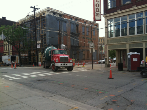 Streetcar construction next to Findlay Market. Both buildings in the background of this picture are being renovated.