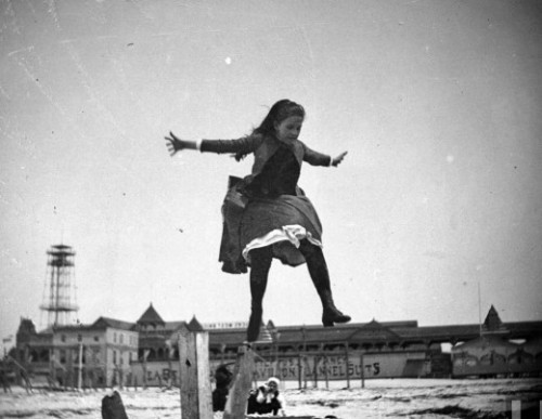 Young Edith Poey jumping off a wooden pole onto the sand at Coney Island, Brooklyn, May 15, 1887  (via Retronaut)