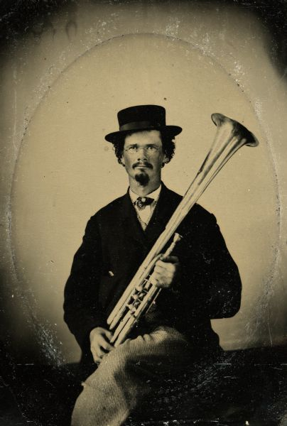 ca. 1861, [Tintype portrait of Joseph Smith, with his tenor horn, of Evansville, Wisconsin, member of the 3rd Wisconsin Infantry band] via the Wisconsin Historical Society, Edwin O. Kimberley: Regimental Band, 3rd Wisconsin Infantry Photographs Collection