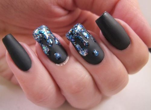 beautylish:  Natalie C.'s glittery drippy nails over a matte black? Love!
