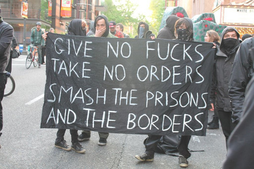 darklyeuphoric:  Give No Fucks, Take No Orders, Smash the Prisons, and the Borders [via Flickr, via @Interdome] Amen. I mean, who can't get behind that sentiment?