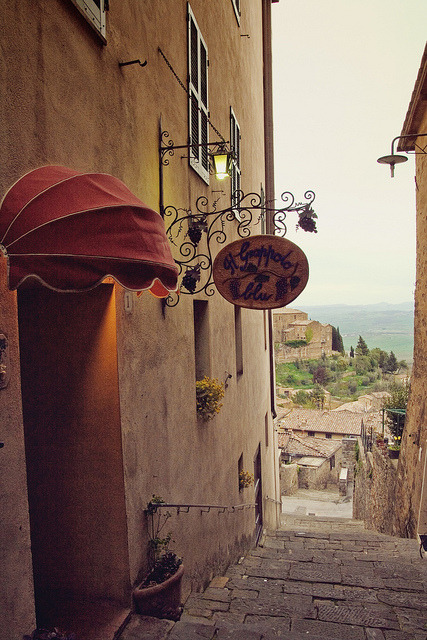 "| ♕ |  Ristorante on the steps - Montalcino, Tuscany  | by © Pug!  Photographer Jenny/Pug's comment on ""Grappolo Blu"": At this Montalcino restaurant, I ate ""the BEST PASTA DISH EVER (!)"" (direct quote from my travel journal - capital letters, exclamation mark and all). It was pinci all' aglione: cherry tomatoes, garlic and basil. No it doesn't sound like much but I think the best pasta dishes I've had in Italy have been the simple ones where the natural ingredients really stood out.I really must have enjoyed this pasta because I remember we went back for a second dinner at this restaurant and I ordered exactly the same dish. I was sad to leave!"