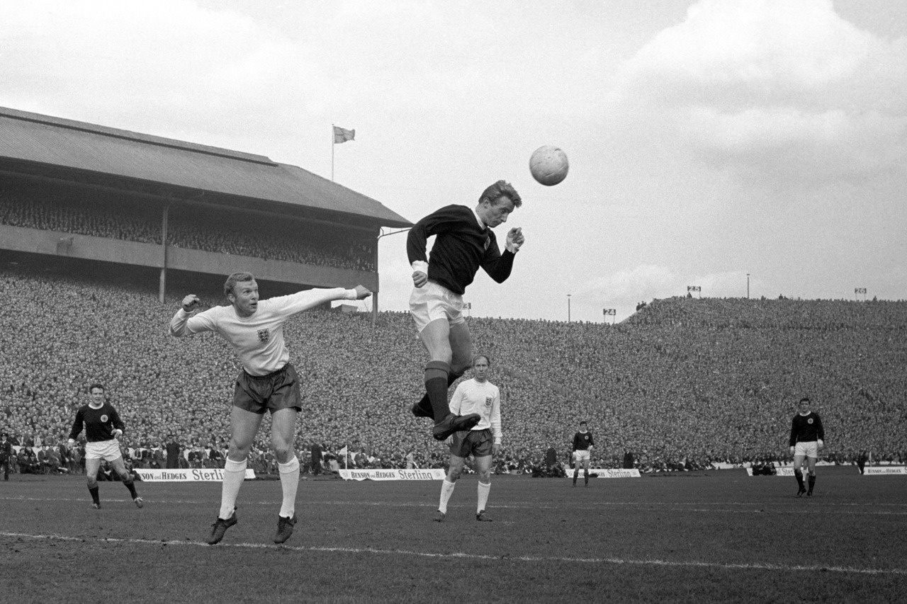 interleaning:  Denis Law v Bobby Moore, Home International at Hampden Park, 1966.