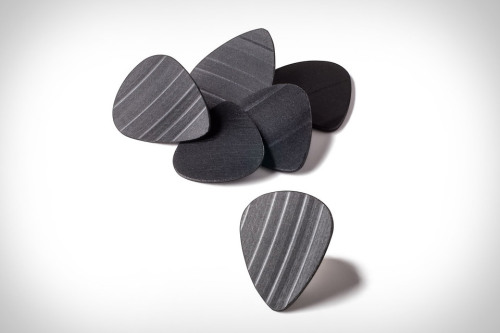 Recycled Record Guitar Picks.  Saw this here.  See more here.