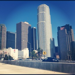 "City of Angels Skyline. This is the second subject of the May ""Photo a day"" challenge.  I took this picture on our road trip to Los Angeles in March. We were on our way back from San Diego and decided to stop in LA for the Fresh Air Beat Swap. This was taken  right as we were about to exit off the freeway. I absolutely love road trips! I could really use one right now! The stress of this week is ridiculous! Although I would never want to live in LA, it sure is fun to visit there once in awhile."