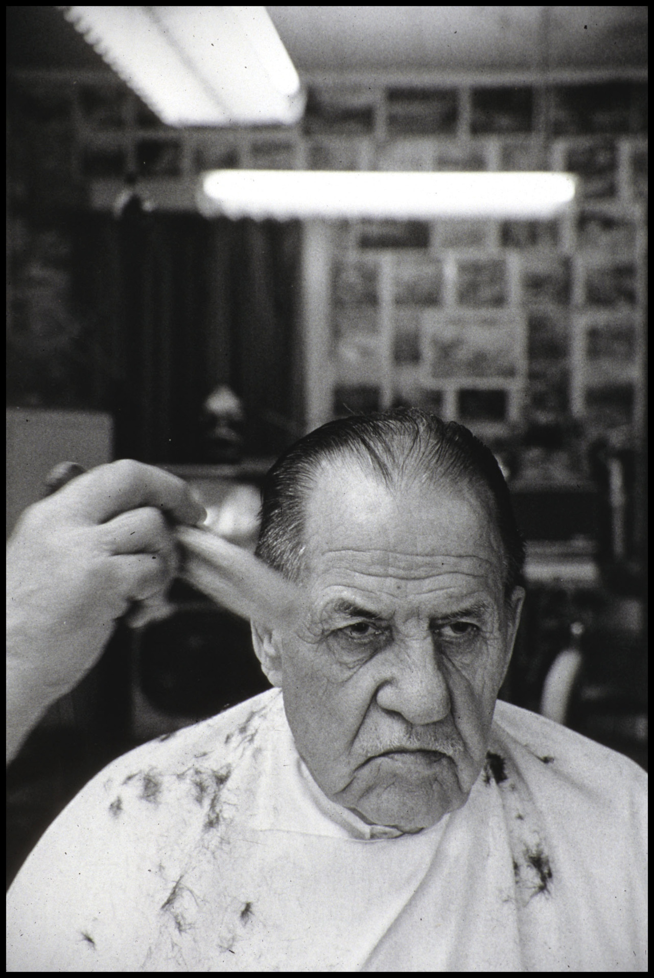 From the Archive - Joe's Barber Shop, St. Paul, MNFrogtown (1993 - 1995) I first started coming here in the 30s when I was 16. It was called Nick's Barber Shop then. Haircuts were 35 cents. Now they're $7.50. Still a good buy. Joe here has been cutting my hair since 1950. I've been a good customer. I get it cut every three weeks. If you can stand his bs you've got it made. That's a lot of bs over 40 years. I guess that's why I come here.