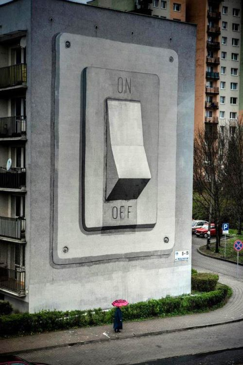 ianbrooks:  On/Off by Escif Part of the Katowice Street Art Festival in Poland. Oh great, who left the world on while we were out?  Artist: flickr (via: streetartnews)