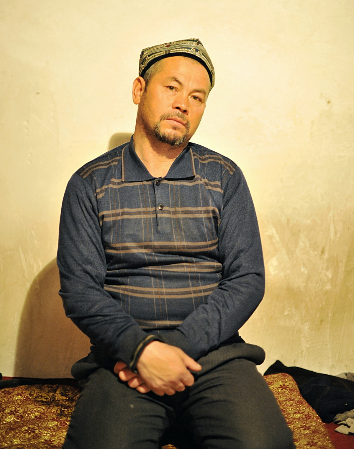 Uyghur Man in his home, Kashgar Xinjiang 2012