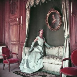 Jane Sprague models a ball gown by Jacques Fath (1953).