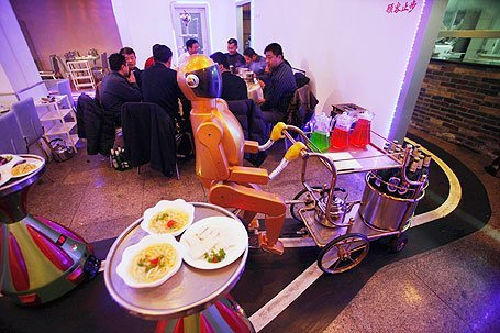 futurescope:  Chinese Restauranteur Boasts 18 Robot Workers  A restaurant in Harbin, China staffs 18 robots; one to welcome customers as they arrive, others to cook the food, and more to deliver plates to tables. The owner says the robots, which cost between 200,000~300,000 yuan ($32,000~$48,000 USD), can display 10 different emotions and speak simple phrases. The robot stops automatically if a customer gets in its way thanks to ultrasonic range sensors, and will sound an alarm if it needs to be repaired.  And it knows to return to its power source when it gets low on juice (its batteries have a life of around 5 hours).   [source]