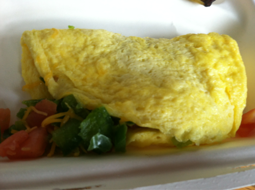 Post-workout meal. An omelet with a little cheese, green peppers, and tomatoes, and a banana.