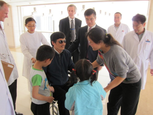 "statedept:  Chen Guangcheng with his family at a hospital in Beijing, China, on May 1, 2012. U.S. Ambassador to China Gary Locke, James Brown, and Regional Medical Officer Wayne Quillin are also pictured. [State Department photo/ Public Domain]  According to Chen, U.S. officials quickly abandoned him shortly after this photo was taken:   When U.S. officials escorted him out of the U.S. embassy shortly after 3 p.m. Wednesday [May 2nd], Chen thought he'd extracted a promise that at least one of them would stay with him at the hospital, he said. ""Many Americans were with me while I checked into the hospital and doctors examined me. Lots of them,"" he told me from his hospital bed, where he's being treated for broken bones in one foot, an injury sustained when he fell after climbing a wall during his daring escape from house arrest late last month. ""But when I was brought to the hospital room, they all left. I don't know where they went."" The ordeal was all the more bewildering because Chen is blind and was hurt during his escape; he needs crutches or a wheelchair to move around.  Chen continued, telling The Daily Beast that he wants to leave the country on Hillary Clinton's plane."