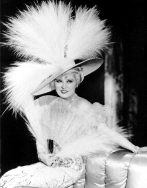 The iconic Mae West in an over-the-top topper.