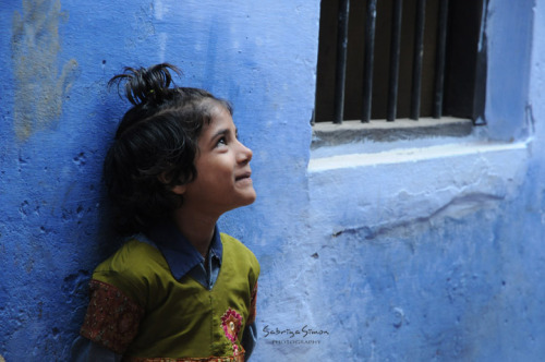 Photo Title: ~ I Look To You ~   |   Image of a shy, young girl in Varanasi, India, instantly looking to her bigger brother the moment she realized the camera was pointed to her.