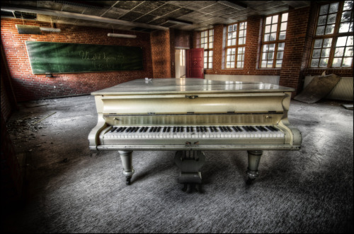 Found this wonderful piano in an abandoned school in Denmark.