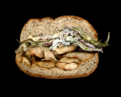 Jin Market: Grilled Chicken, Sprouts, Onions, Provolone, Mayo, Mustard, On a Whole Wheat Roll.