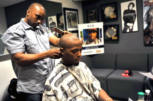 April 29: Rapper B.o.B gets a haircut before performing live on 'Hip Hop Nation' in the Sirius XM studio in New York City.