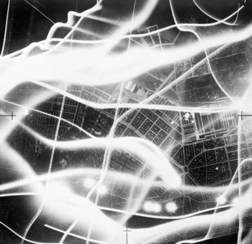 An aerial photograph taken during an air raid on Berlin, with the wavy lines of searchlights and anti-aircraft fire, 1941.