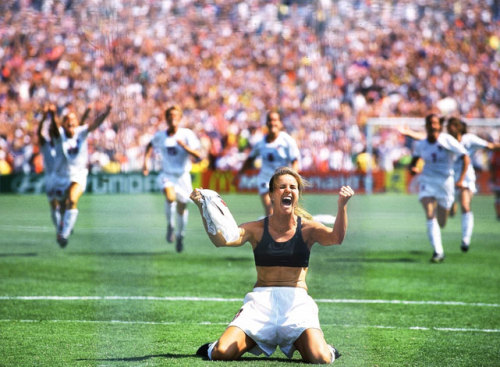 siphotos:  Brandi Chastain celebrates after scoring the winning shootout goal against China to give USA a victory in the 1999 World Cup final. (Robert Beck/SI) GALLERY: Top 40 Athletes of the Title IX Era