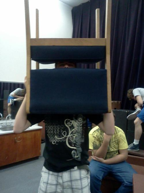 Ben decides to rehearse a dance with a chair on his head.  People think these are staged but they really aren't. He just randomly does these things and we freak out trying to get a picture.