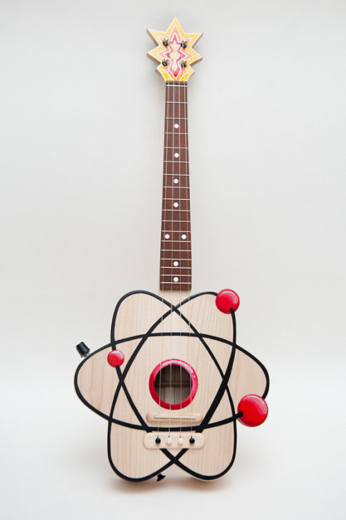 jtotheizzoe:  wnycradiolab:  kqedscience:  The atom ukulele!  So dorky!  So good!  Atomic formula AlOHa. (Element 105  … yeah, Hahnium … sometimes you gotta make a stretch)