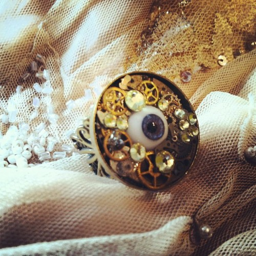 Detail:Bio-mechanical Evil Eye ring- Swarovski crystals, vintage watch gears, glass German eye ( blue) on a filigree adjustable ring #etsy #macabre #evileye  #steampunk  (Taken with instagram)