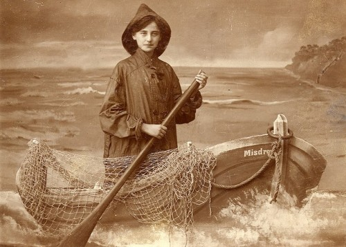 Vintage souvenir arcade photo - young lady as a fisherman