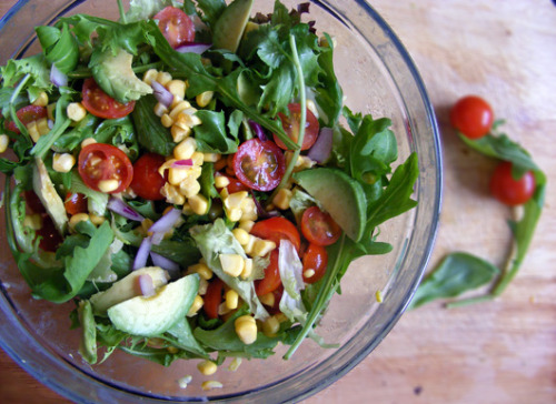 Fresh Sweet Corn, Cherry Tomato and Avocado Salad For the salad: 1 cup of rucola (AKA arugula/rocket/jarjeer) 2 cups mixed leaves or greens of choice Raw sweet corn kernels from one ear of corn 1/2 cup cherry or baby plum tomatoes, halved 1/2 an avocado, sliced Toss the rucola, leaves, sweet corn and cherry tomatoes together, then layer avocado slices on top. For the red onion balsamic dressing 1/2 a small red onion, finely grated 2 tbsp balsamic vinegar 1 tsp extra virgin olive oil 1 tsp lemon juice. 1 tsp agave nectar (or maple syrup)* Dash of sea salt and pepper to taste * Any liquid sweetener would work, but agave is best as it has a clean sweet flavour as opposed to molasses which may have more of a distinctive caramel taste. Don't skip out on grating the onion here, it turns it to this wonderful, almost chutney-like consistency. Whisk together other ingredients and try not to drink the whole thing when you taste-test. Drizzle over salad just before serving.