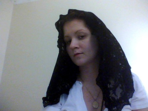 Here is the mantilla that I sewed. I think I did a pretty darn good job considering it is the first one I've ever made, and I sewed it by hand while sick in bed. Awesome!