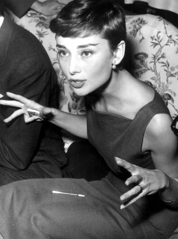 Audrey Hepburn being sassy. Circa 1954.